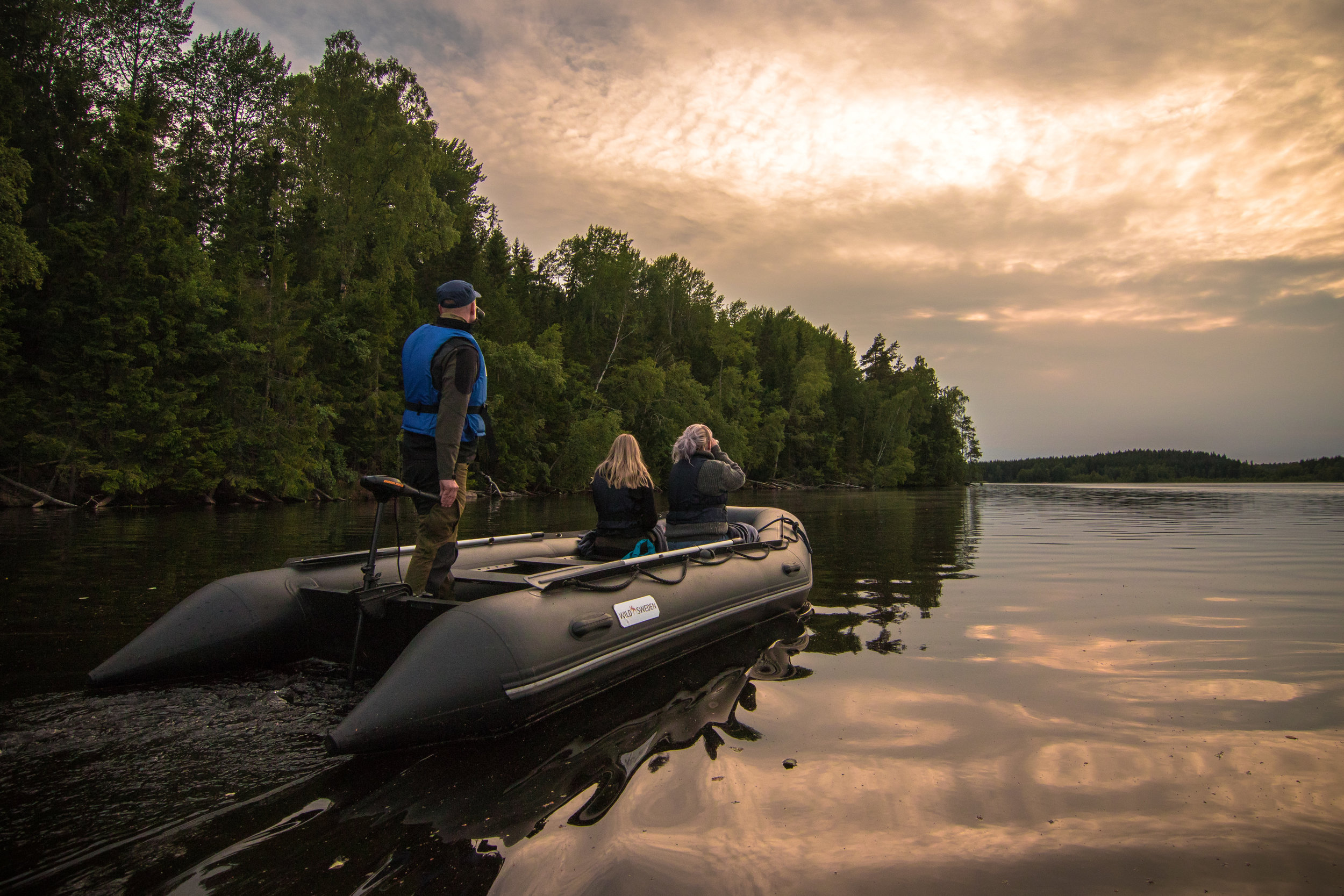 In search of beavers using a rubber boat with a silent electric motor. Photo: Simon Green