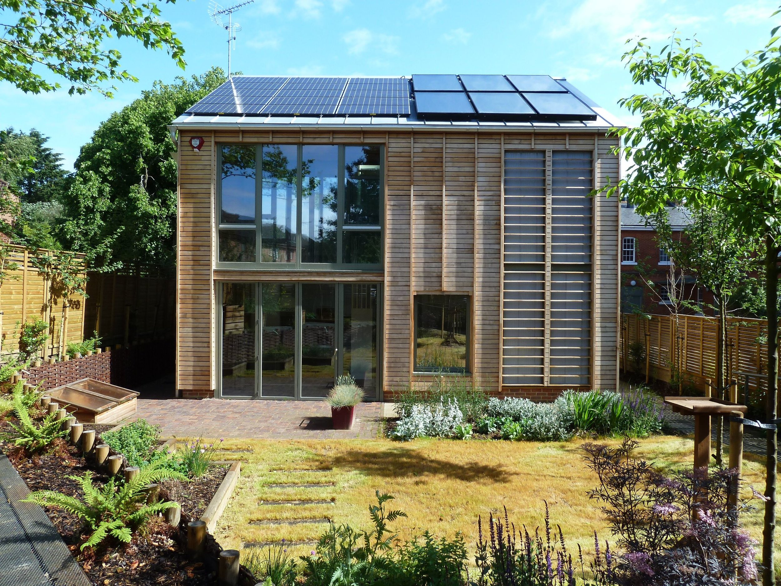 The ECO House - The Bordon Eco House is an innovative zero carbon house, the first in the UK to include inter-seasonal heat storage. The system includes a 9m3 buried thermal store which is used to store solar energy during the warmer months for the heating during the winter. The house design also includes an innovative trombe wall incorporating nanogel and clay blocks for thermal storage, winter garden, rainwater harvesting and a thermo ground-air heat exchanger for preheating the air in winter and cooling the air in summer.