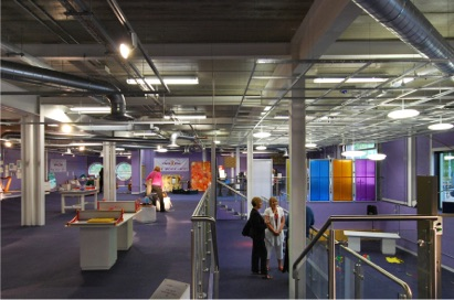 Science Alive, Harlow - A new exhibition and teaching space on a very tight budget within a newly built sport centre. This conversion of an existing sports centre was designed to promote science to the community as an educational resource. The architects were asked to create a flexible space for science-based exhibits including the 'pit', a double height space for shows or activity. The services were designed to provide flexibility in layout and for temporary exhibitions including flexible three phase power supply and plug in additional spot lighting