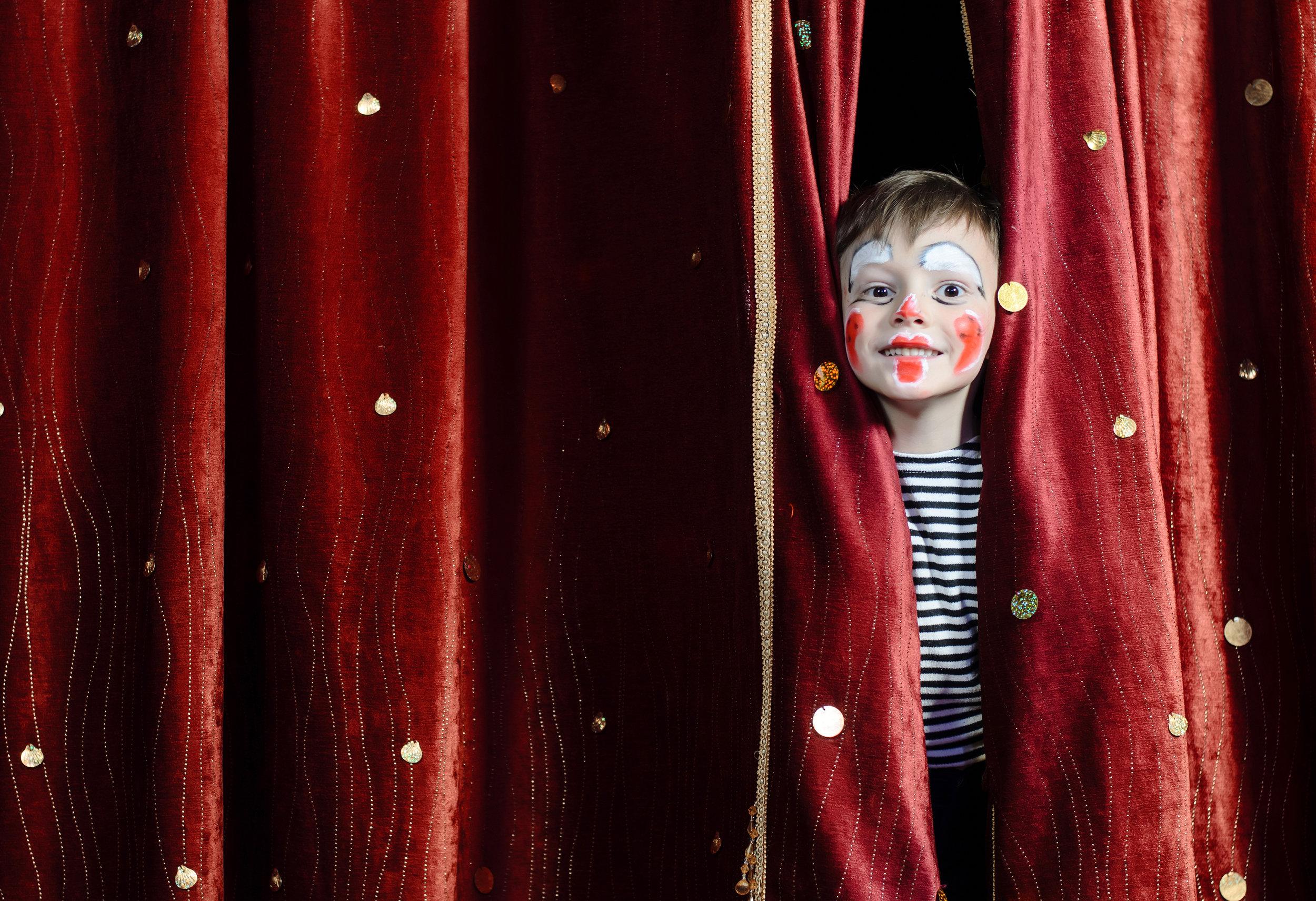 Happy Boy Through Curtain.jpg