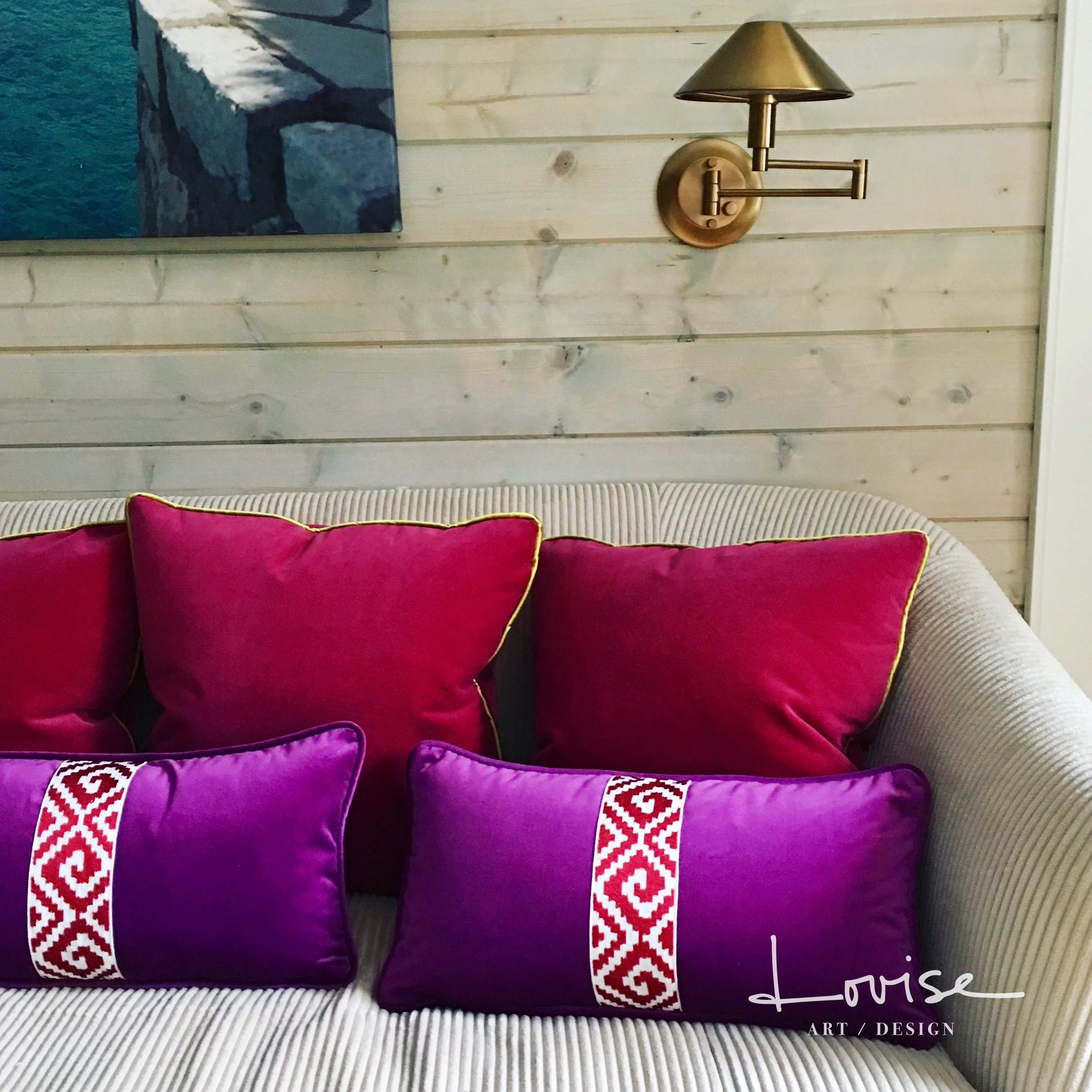 Custom pink and purple velvet pillows with brass sconces