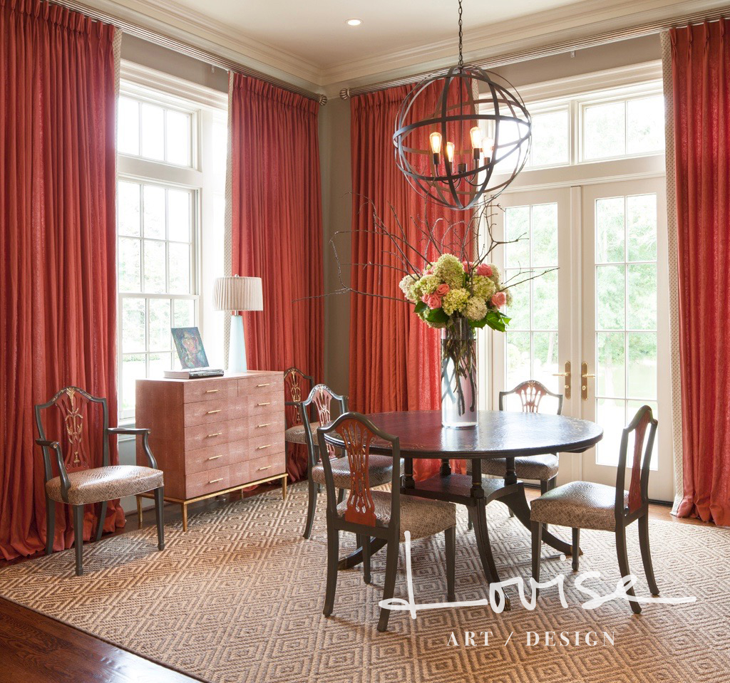 Round dining table with coral draperies and shagreen chest