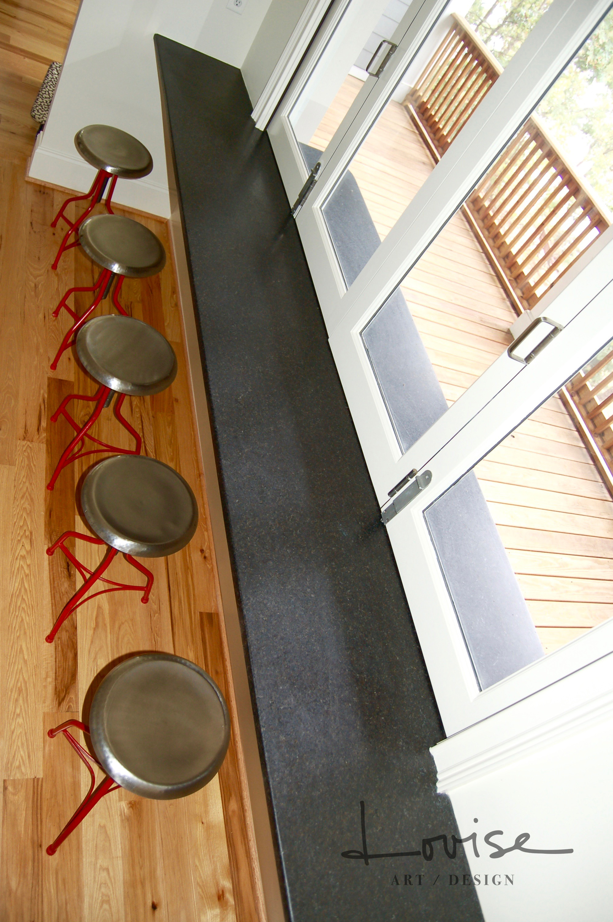 Pass-through entertainment bar with red metal stools