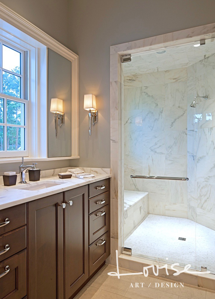 Master Bath with paneled vanity, nickel sconces and Calcutta gold marble shower