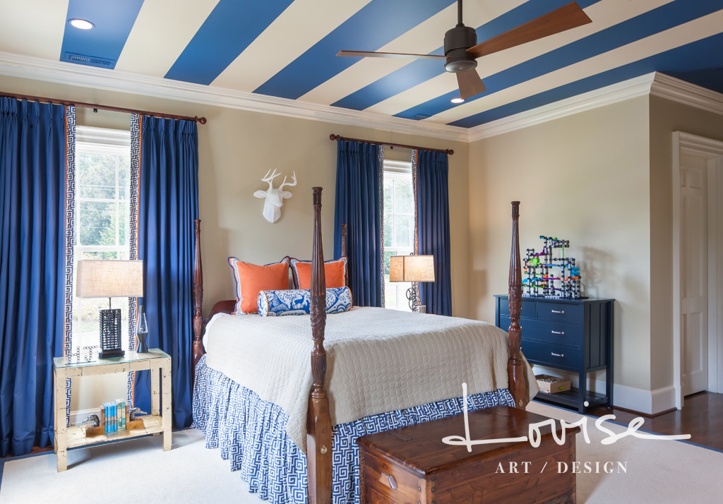 Bedroom with navy and tan striped ceiling and custom details