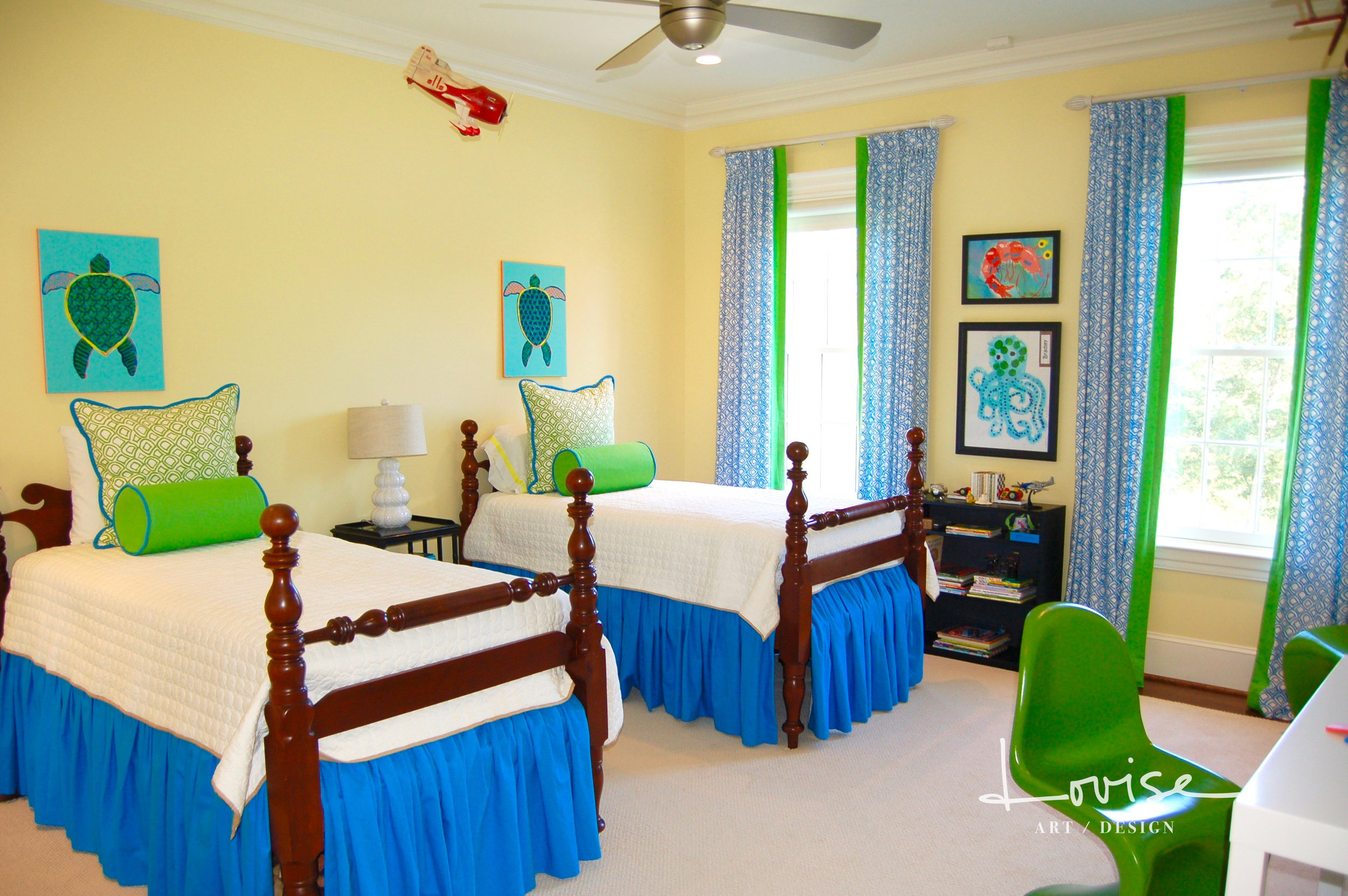 Childs bedroom with custom blue and green window treatments and bedding