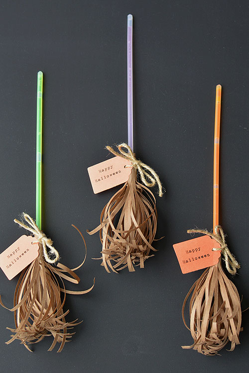 I just love these glow stick brooms by  One Little Project . I can picture handing them out at trick or treat (we support  FARE's Teal Pumpkin Project  and hand out non-food treats so any kids with food allergies can also have a safe & happy Halloween). My older kids will be able to help me make these adorable brooms.