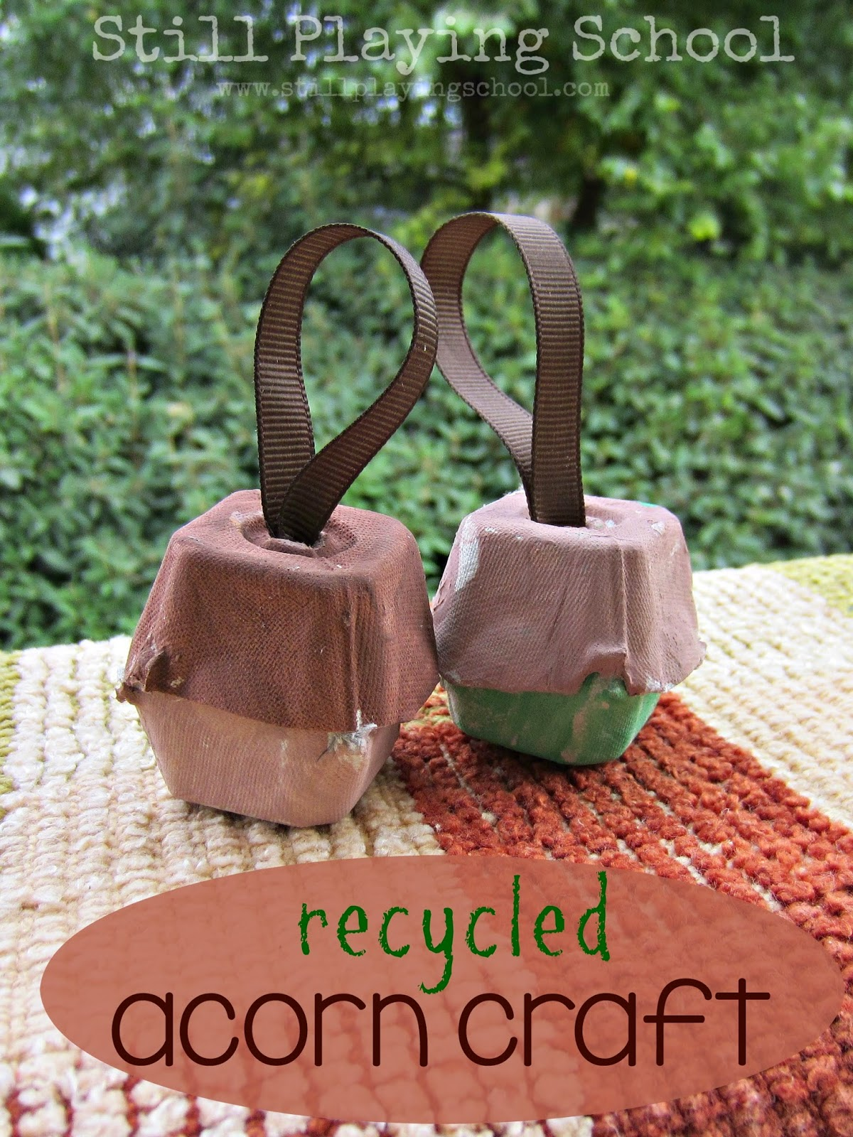 These simple acorns are created by  Still Playing School  by cutting and painting repurposed egg cartons.