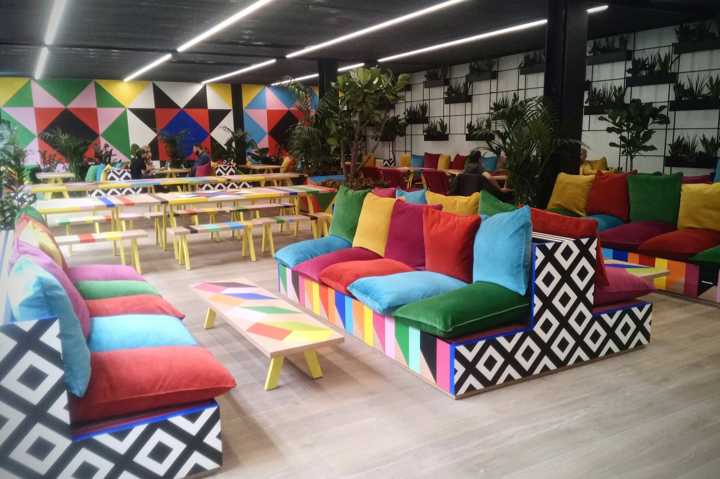 bishopsgate - Design project by artist Morag Myerscough.Over 120 scatter cushions made to fit in with her re-imagined office space on Finsbury Avenue.