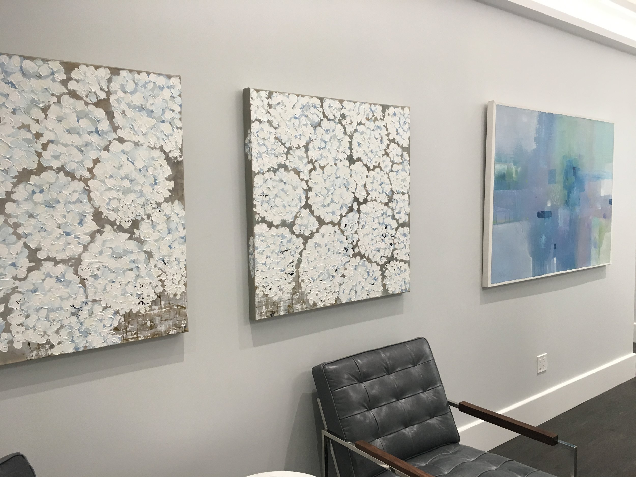 Works from left to right: A diptych by Kim Romero and watercolor by Penny Putnam.