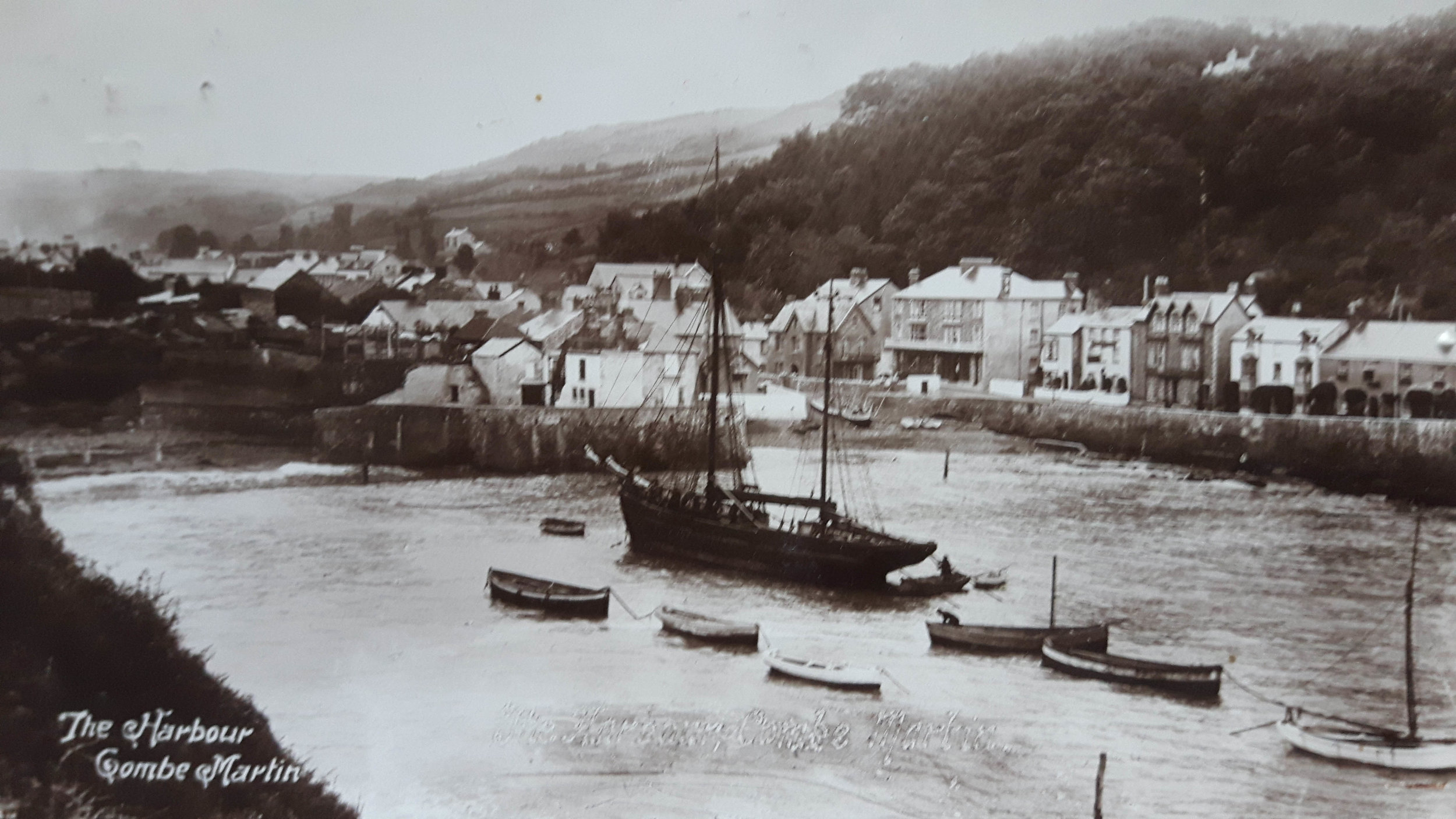 Vintage postcard of the harbour at Combe Martin