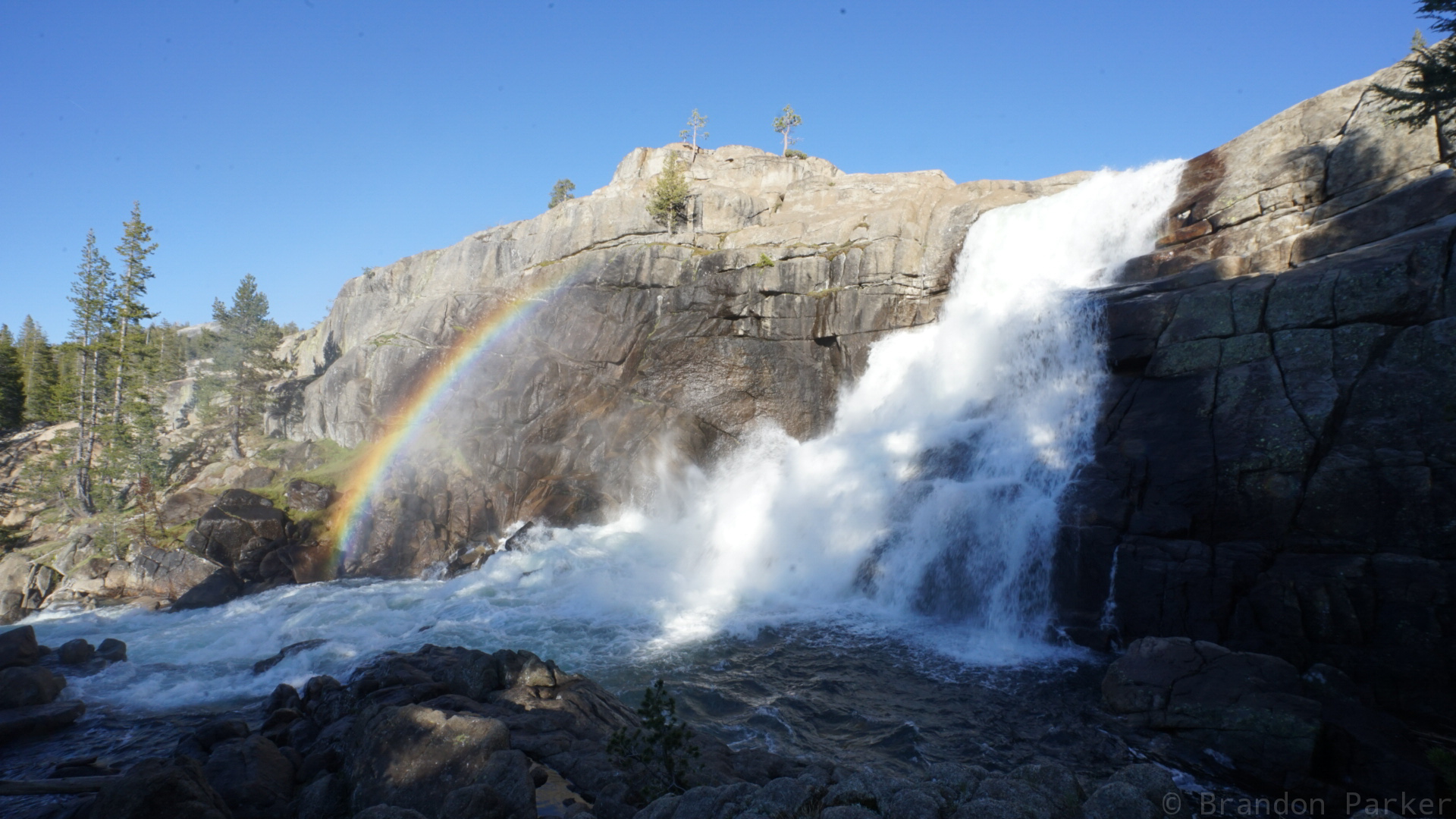 Rainbow caused by waterfall spray just outside of Yosemite Valley