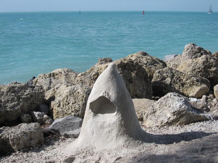 Sand mound for muffling sound