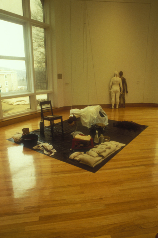 ACTION: CONSTRUCTION OF GUARDIAN  1994  Plaster life cast, kelp backed with natural latex and waxed felt, needles, thread, water, custom sand bags, solo exhibition,  Under the Skin,  Williams College Art Museum, Williamstown, MA.