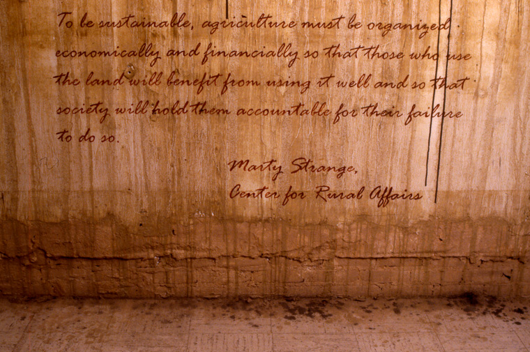 View of walls stained with local pigments and lettered with text from Marty Strange, Center for Rural Affairs.