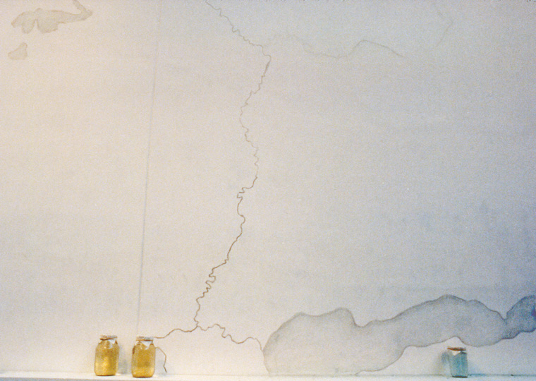Detail of wall-map drawing and water samples in jars.