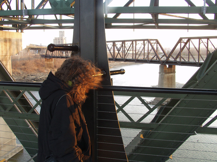 View of Confluence Station, viewer looking at the confluence of the Missouri and Kansas Rivers (albeit through a railroad bridge). Photo: Tim Dalton