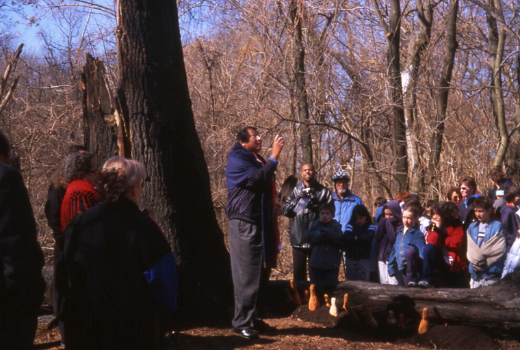 Eddy Red Eagle, principle mentor to the artists, blessing the site in the Osage language, March 2003