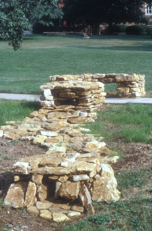 Detail of lintel structure and stone lined water channel.