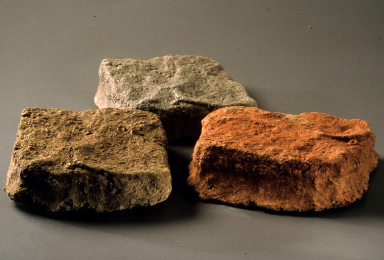"Turning the Tide , choreographer Melli Hoppe, Detail of three soil stones with soil from Bagdad, KY, Mt. St. Francis and the Mingo Nation, Ohio, 2003, 12 x 14 x4""."