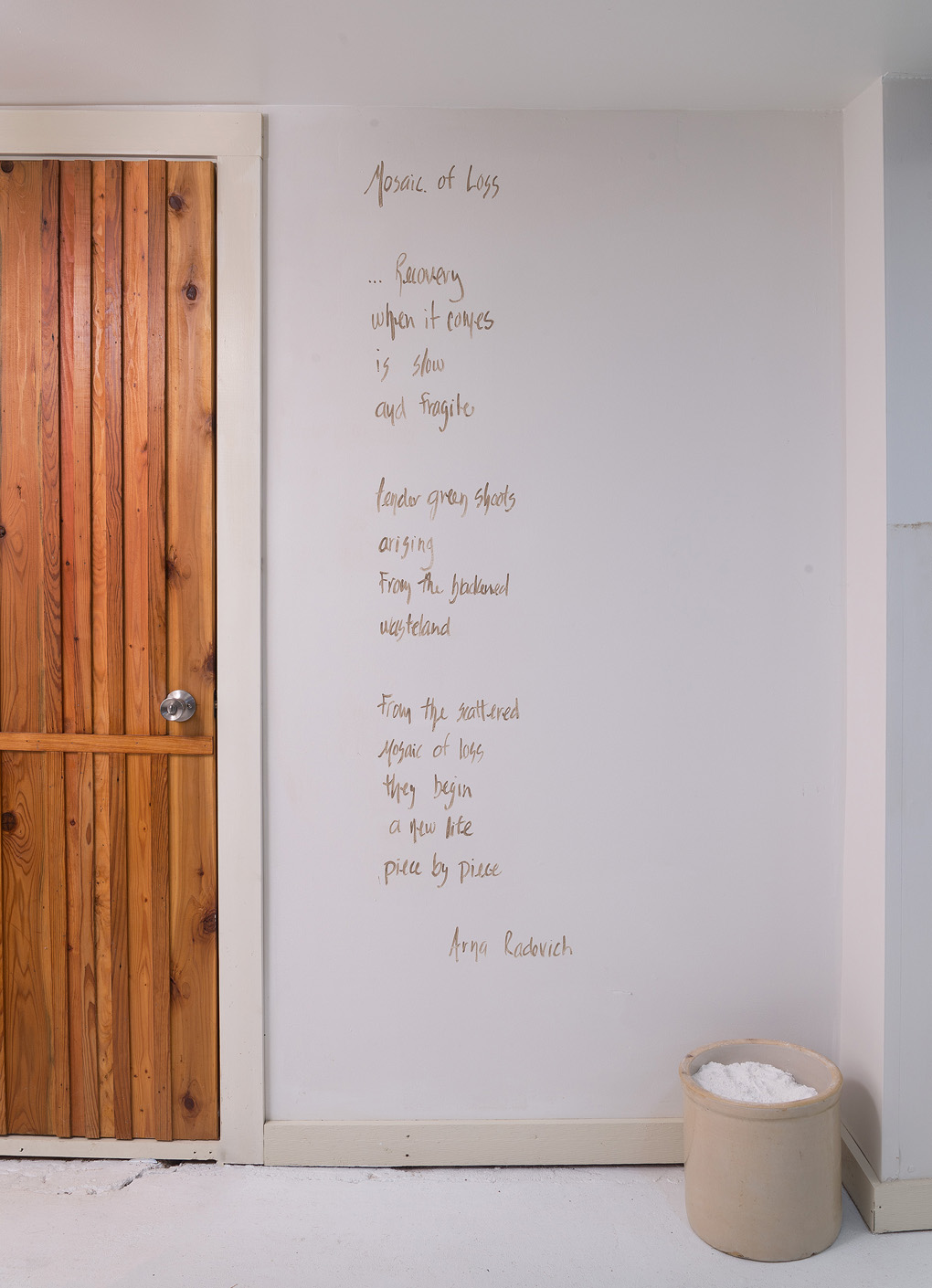 Installation detail of Arna Radovich poem written in Kansas mud.
