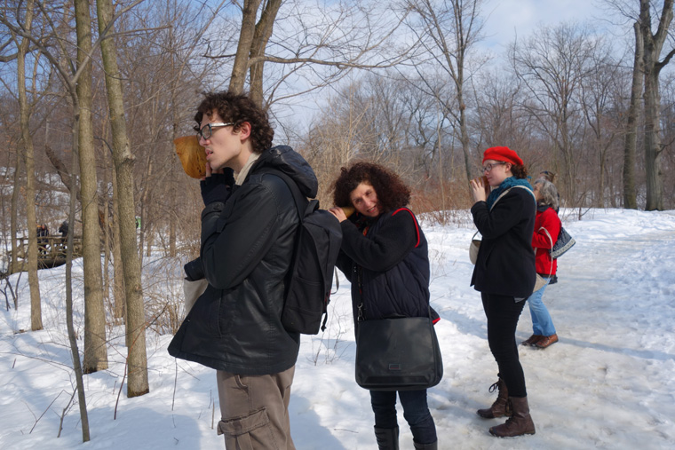 Listening to water trickling under ice on the Loch, Ten hand carved wooden burl trumpets used by participants, walk planned and led by Karen McCoy by invitation of the Walk Exchange, NY. (photo: Karen McCoy)