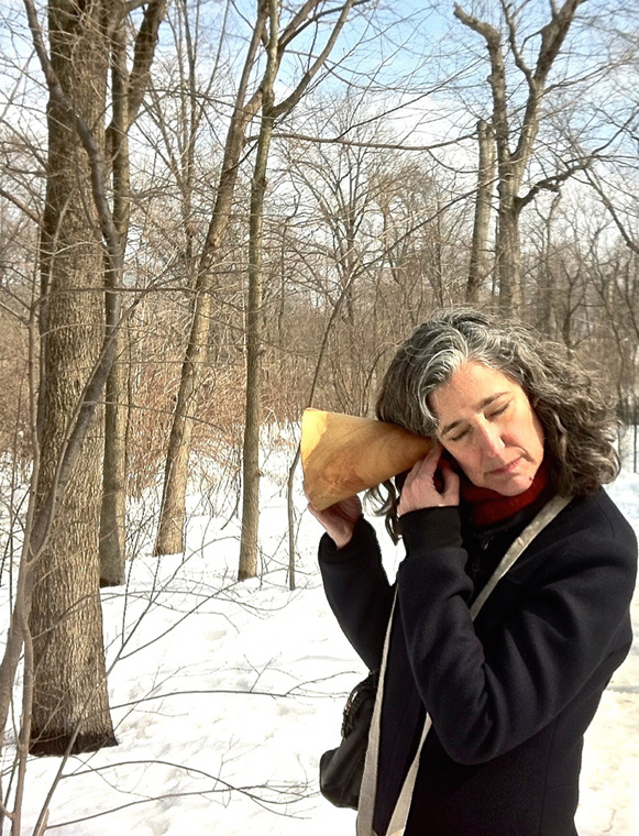 Lydia listening intently to the Loch, hand carved wooden burl trumpet in use, walk planned and led by Karen McCoy by invitation of the Walk Exchange, NY. (photo: Julius)