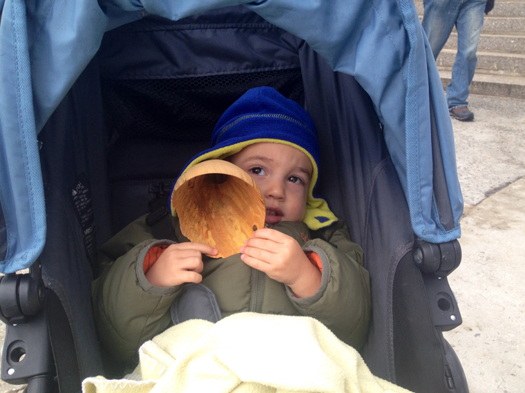 The youngest listener in the North Woods, Sound and Sight Walk, Central Park, New York City, March 8, 2015. Ten handcarved wooden burl ear trumpets used by participants. Walk planned and led by Karen McCoy by invitation of the Walk Exchange, NY. (photo: Virginia Millington)