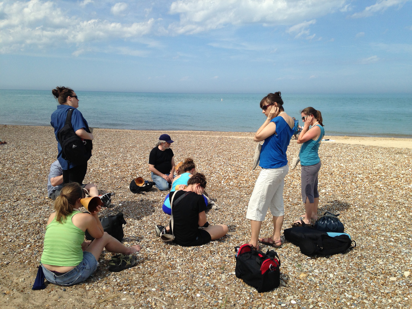 """Performing John Cage's 4'33"""" at Loyola Dunes Beach, hand carved wooden burl trumpets in use, walk planned and led by Karen McCoy, sponsored by Alternative Spacetime 1300 (artist residency), Chicago, IL. (photo: Karen McCoy)"""