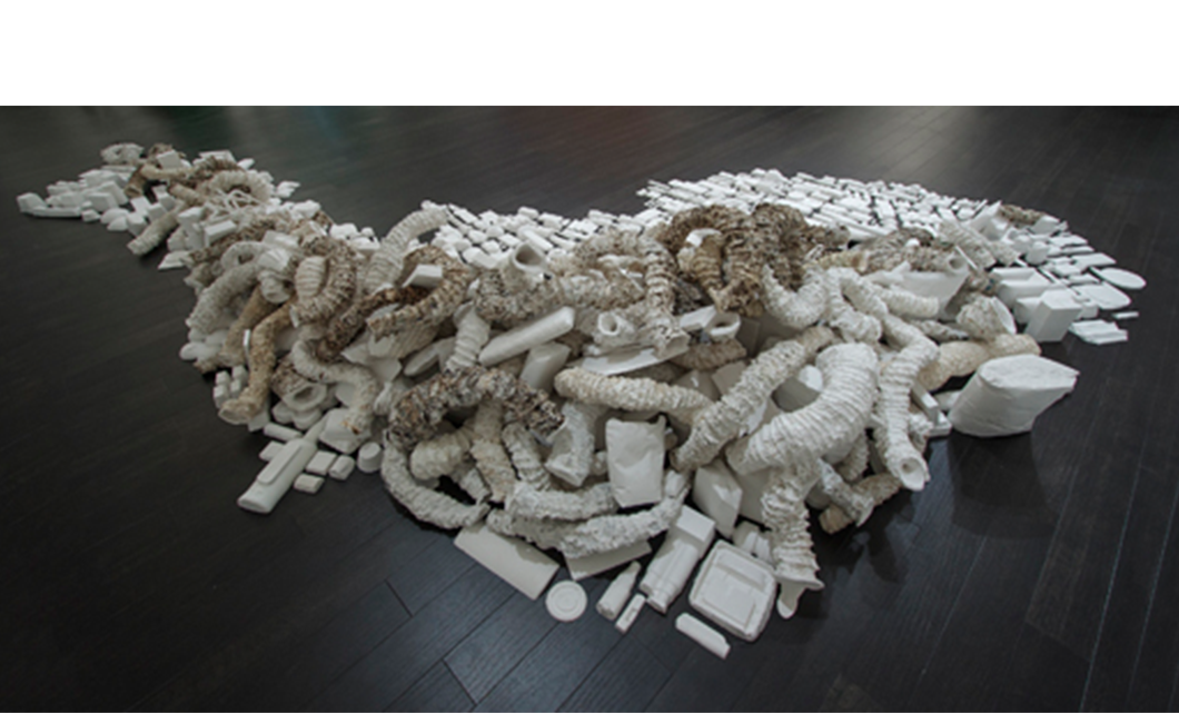 Seemingly Unconnected Events V4  2007- 2014 (ongoing)  Hundreds of plaster casts of organic forms stacked and interlaced with consumer goods casts, 15 x 7 x 2.5'  Installation for Re Imagine, Three Person Exhibition, Epsten Gallery, Village Shalom, metropolitan Kansas City, 2014   Photo: E.G. Schempf