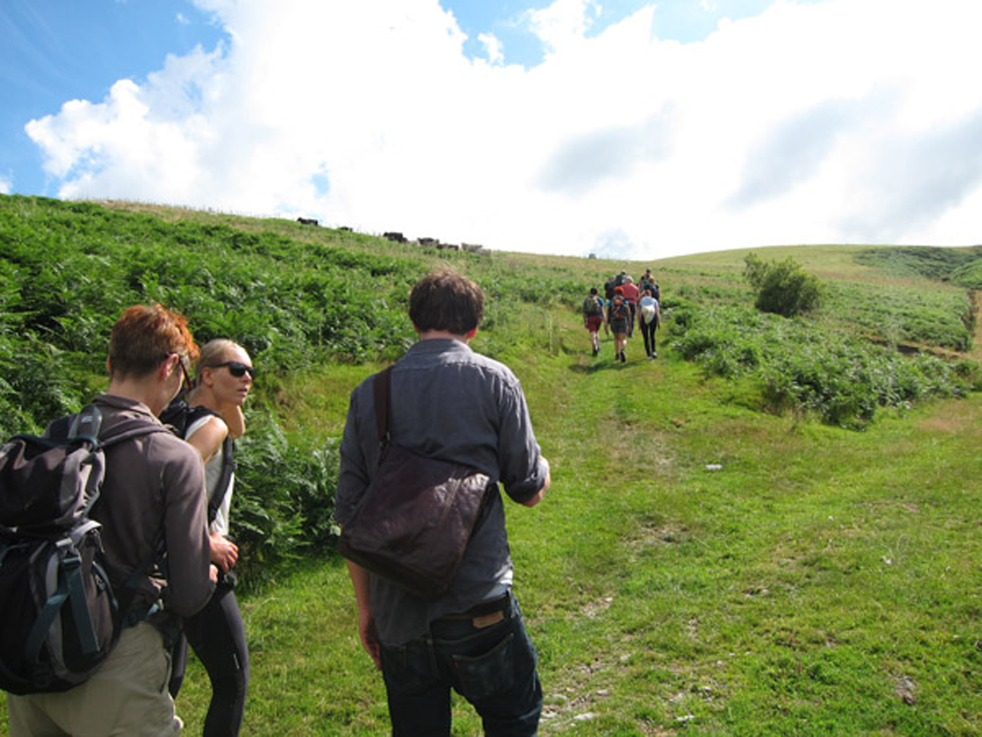 Footwork group leaving CAT to walk with Jess Owens to the wind turbine array in the Welsh countryside that was the subject of her film.