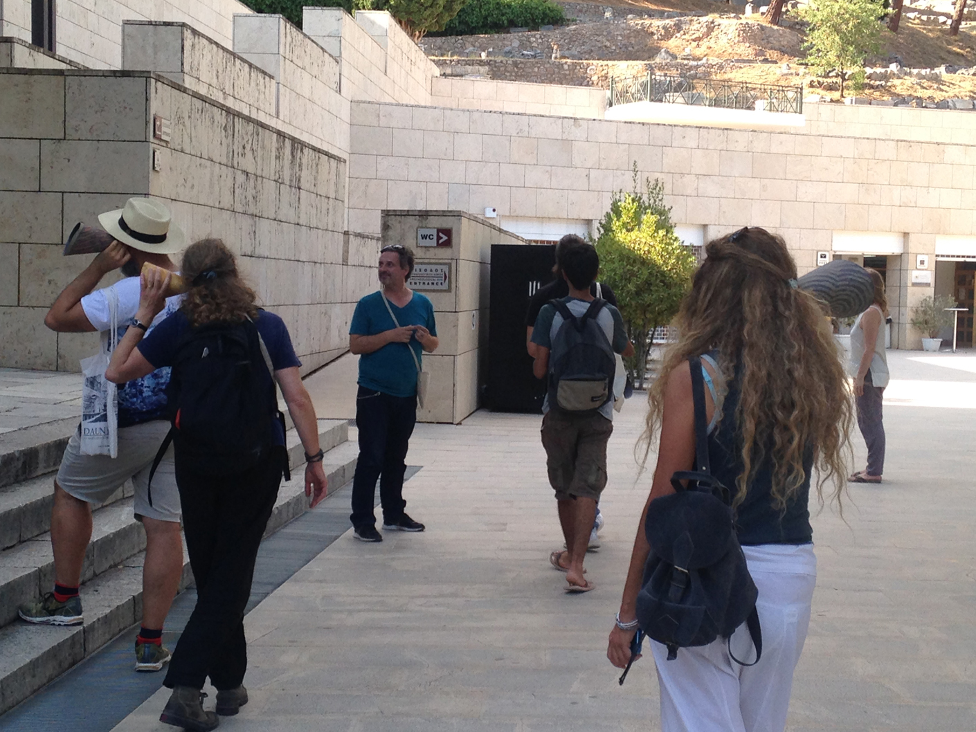 Listening in the courtyard of the archaeological museum at Delphi