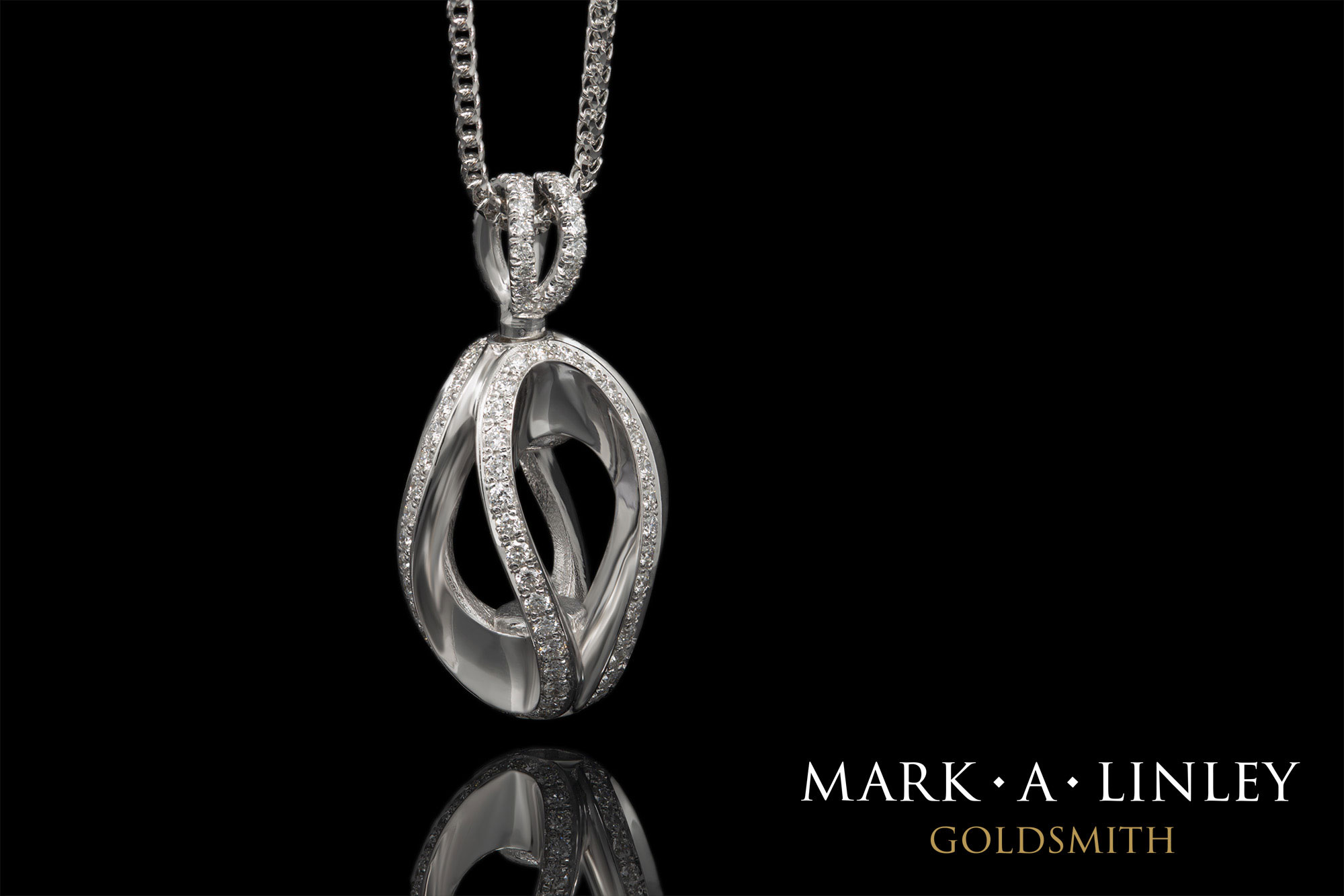 18ct-white-diamond-infinity-catch-pendant.jpg