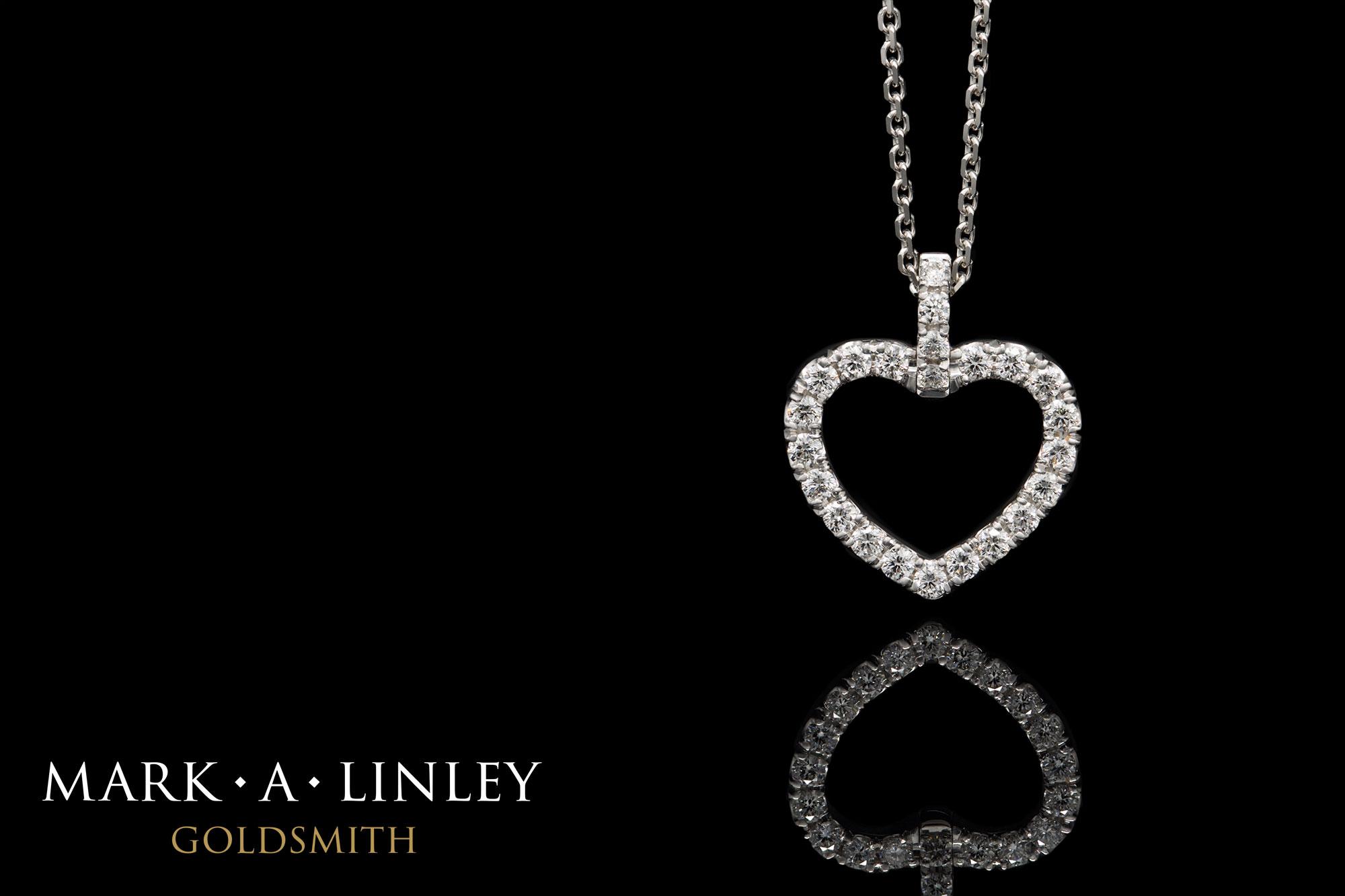 18ct white gold diamond set heart pendant