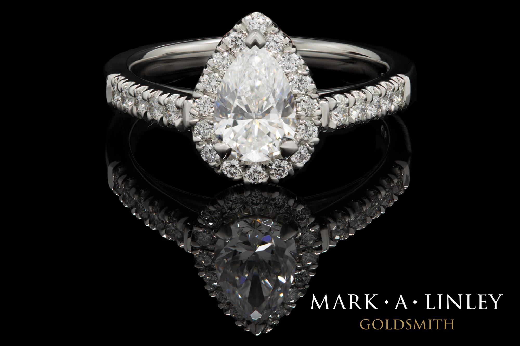 Platinum pear-shape halo diamond ring