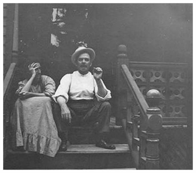 Original Builder Mr. & Mrs. C. W. Fraser on their back porch of their Main Street home