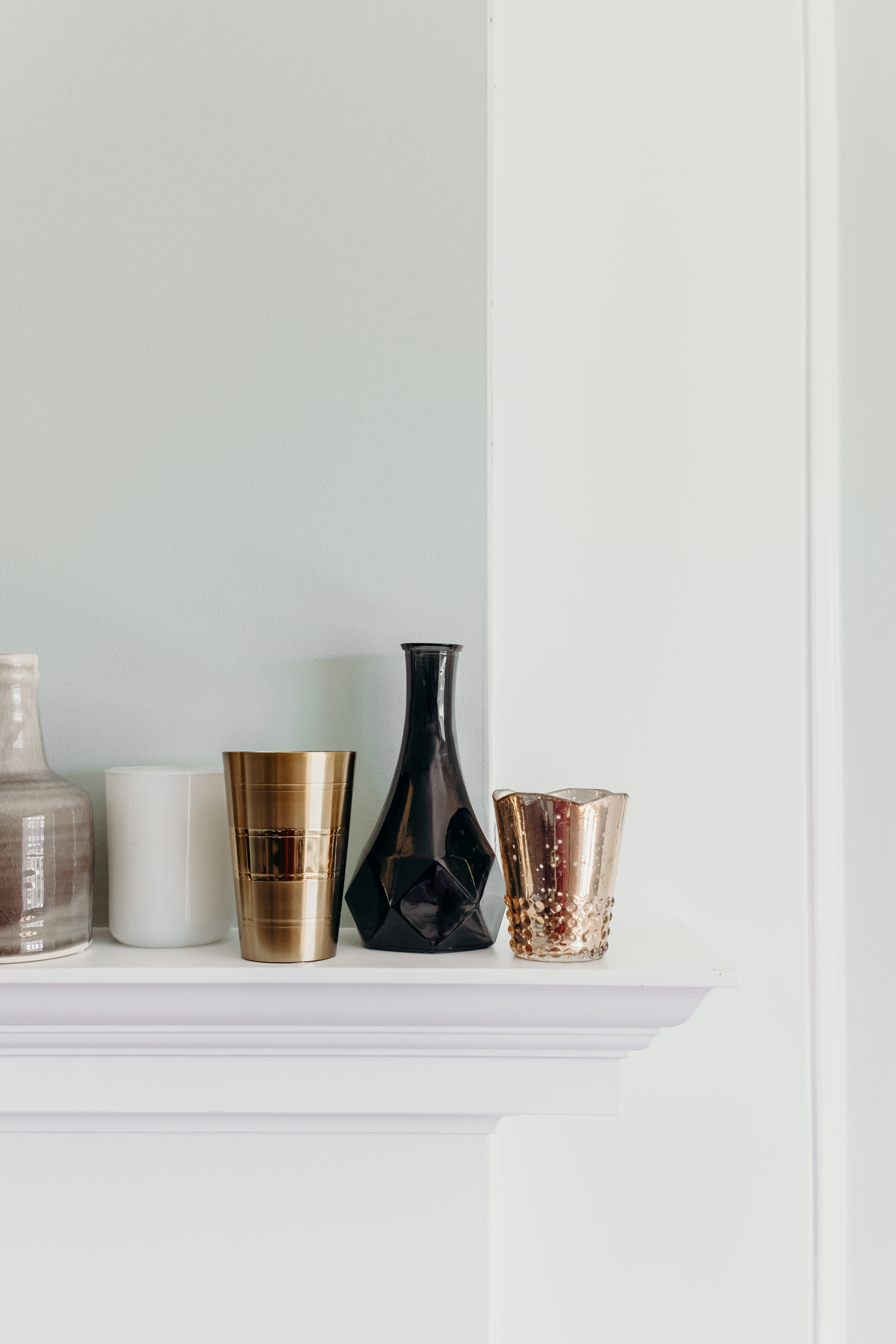 Fireplace mantle with eclectic vases