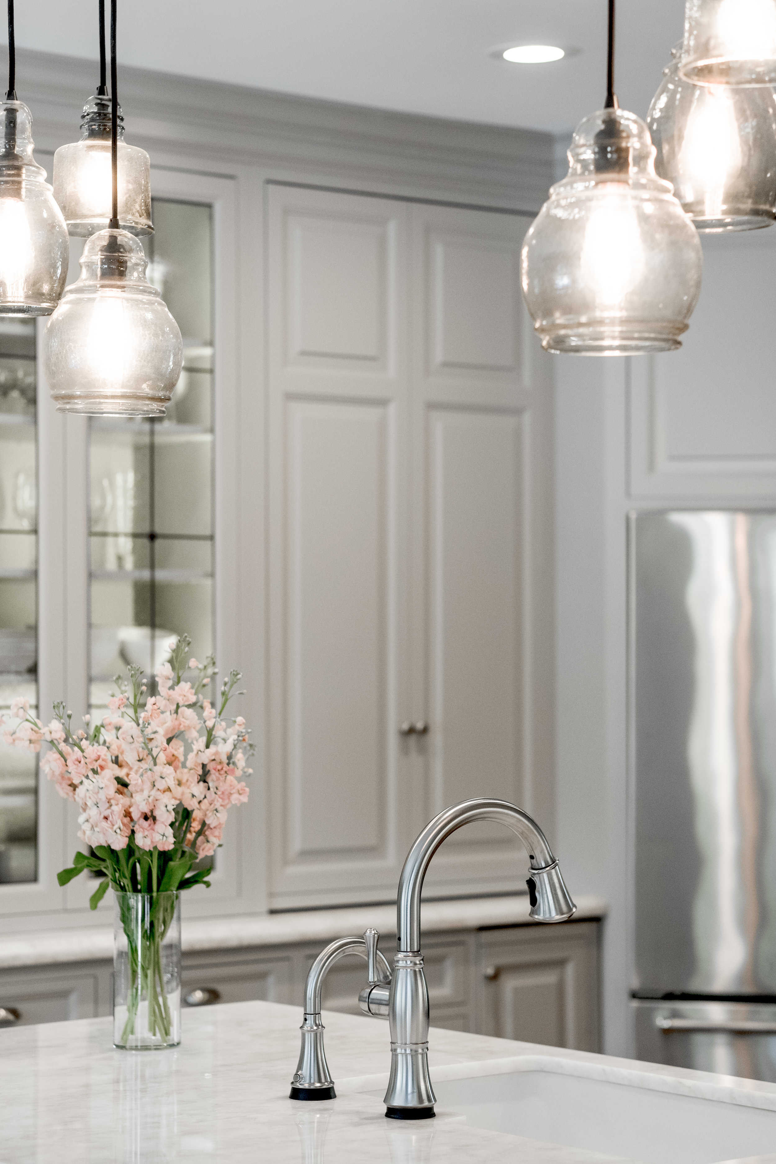 Beige kitchen cabinets with chrome accents