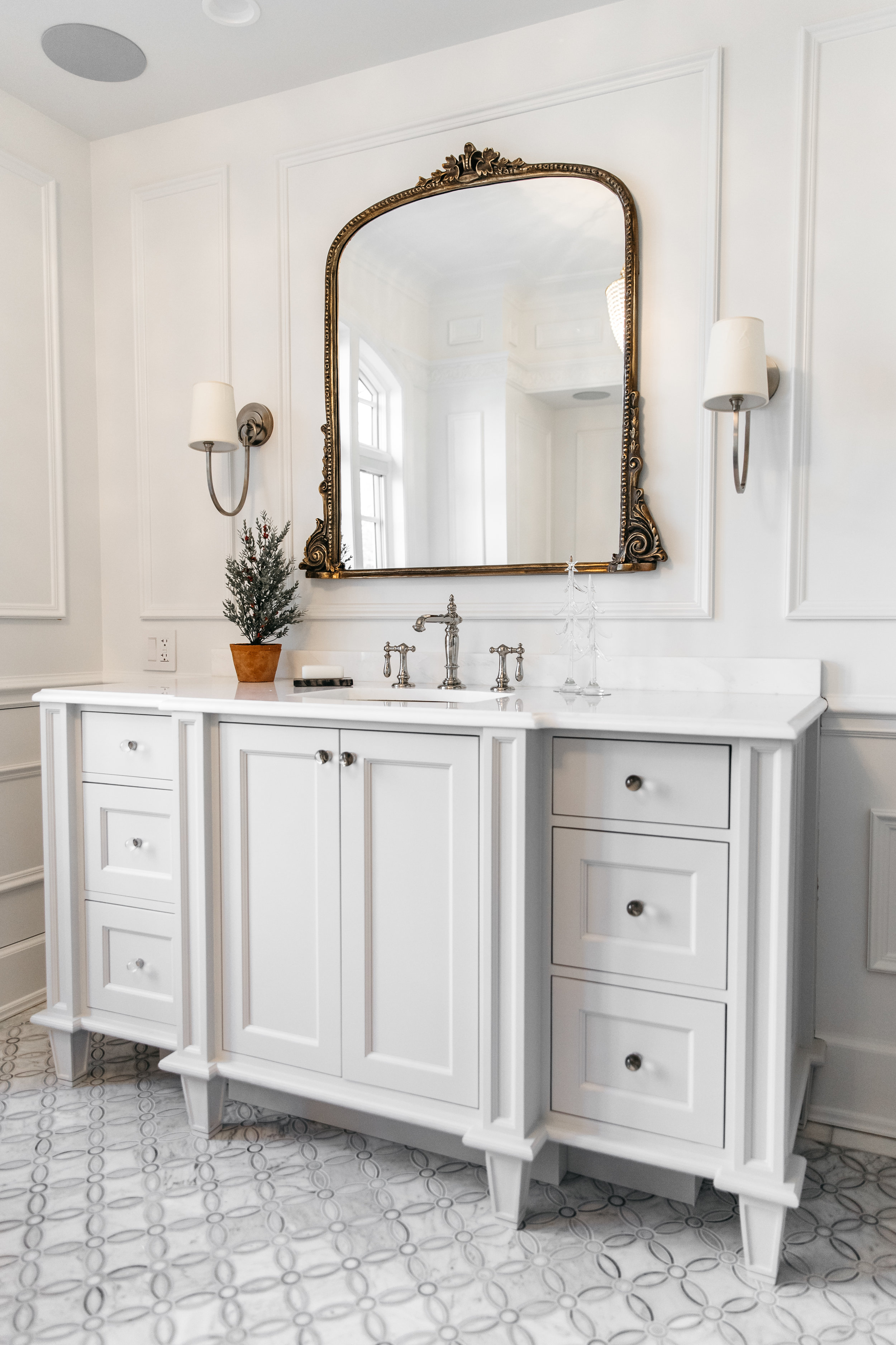 - Adding a festive faux tree to your bathroom vanity is a subtle way to add holiday flare.