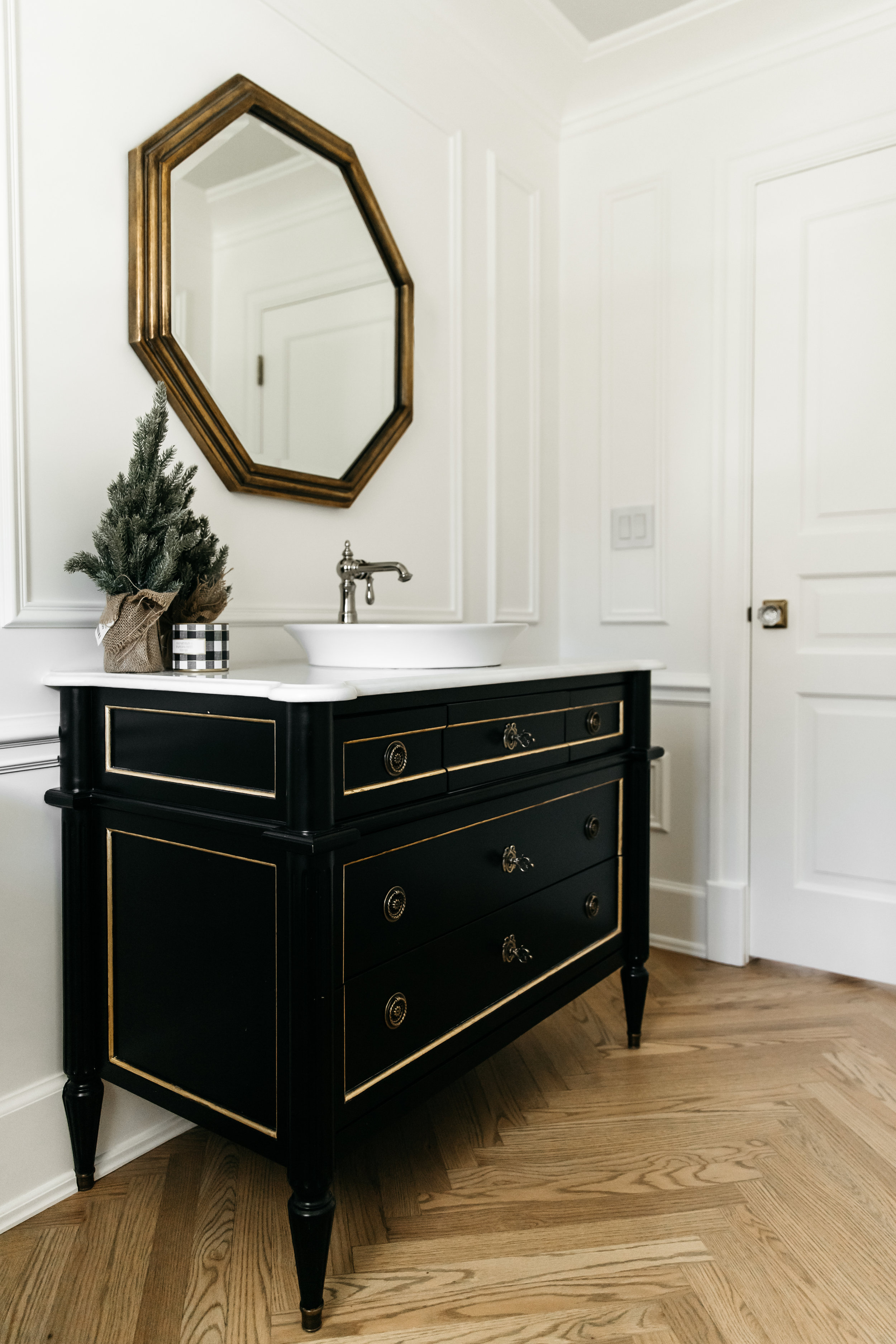 Black bathroom vanity with holiday decor