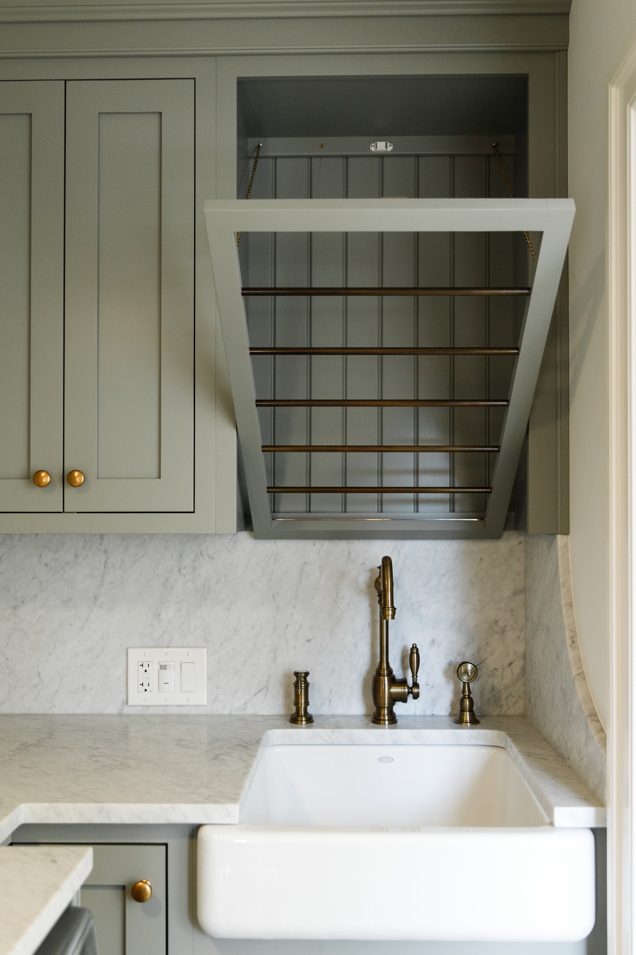 Brass hardware and cabinets painted in Pigeon by Farrow and Ball