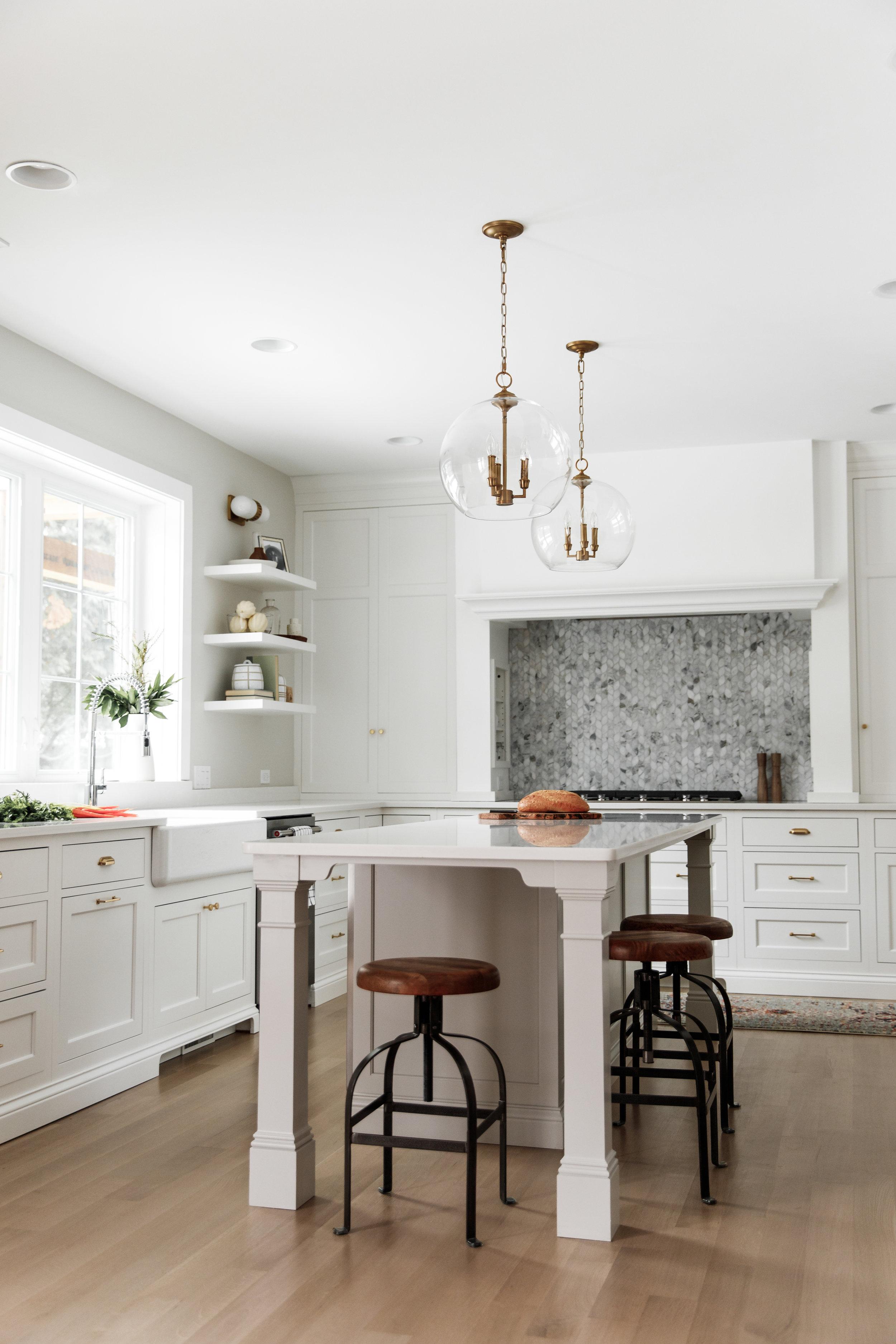 Unique island in white kitchen