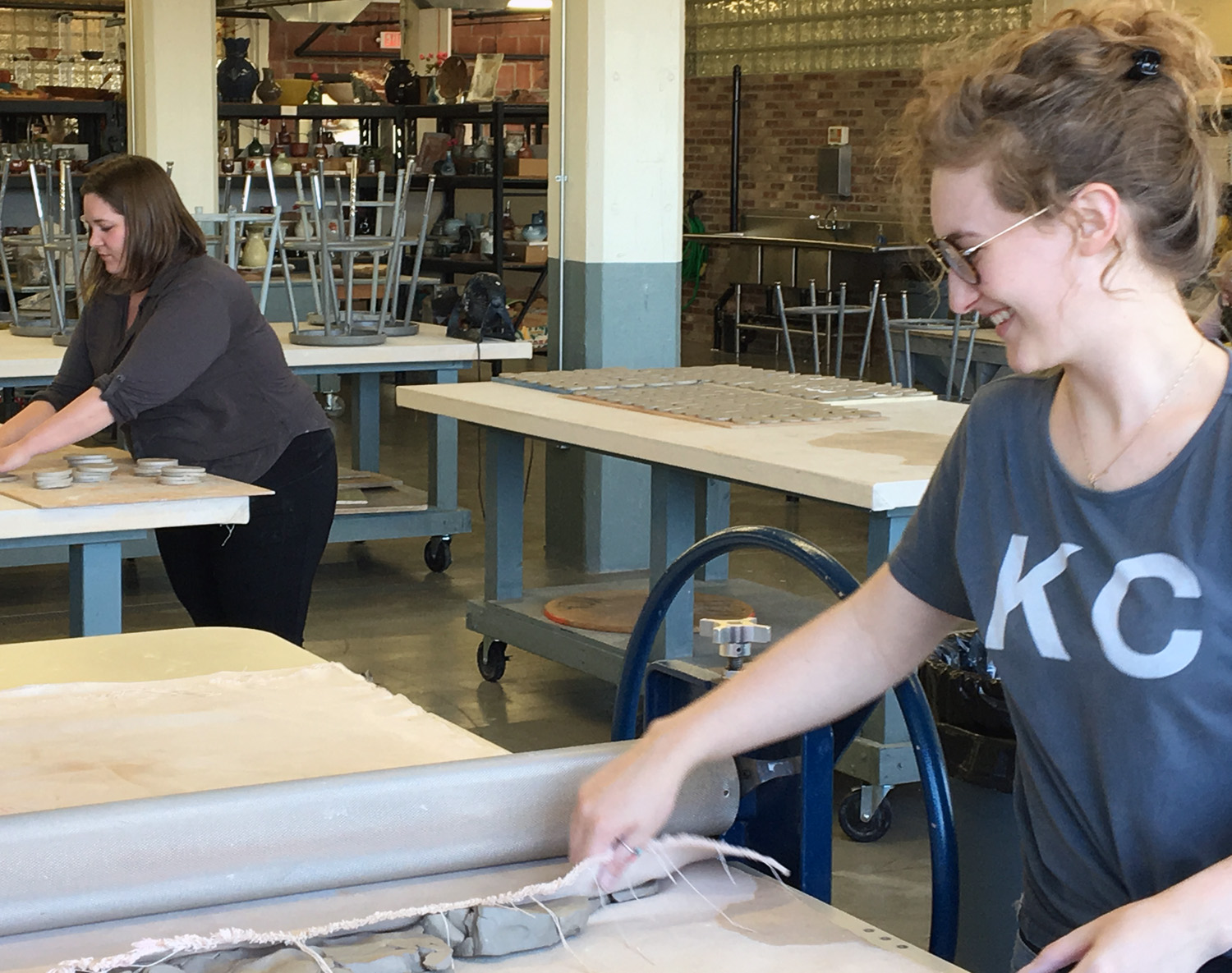 Sarah Olsen and Emily Connell on slab roller - print.jpg