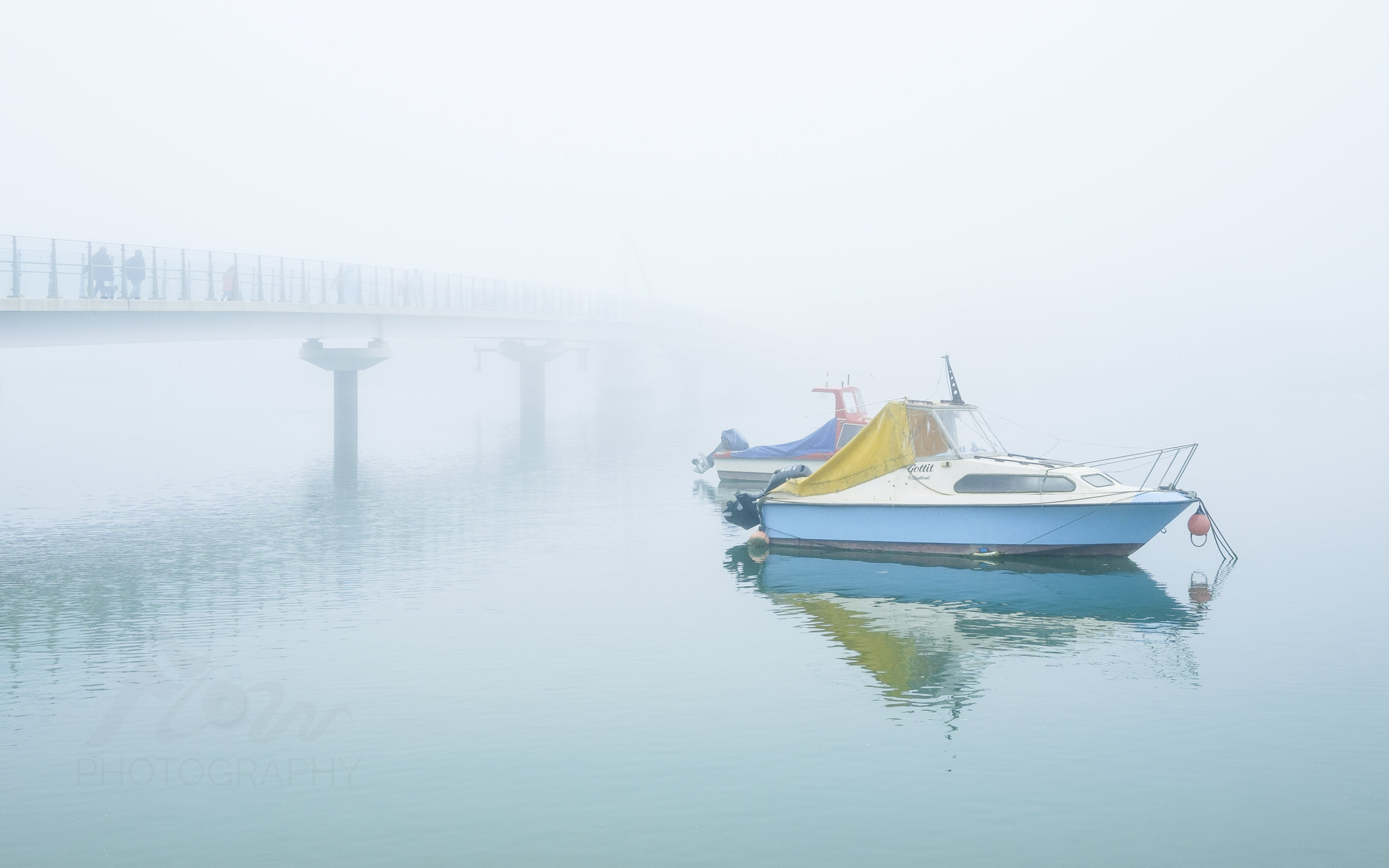 Ghostly   The River Adur Ferry Bridge disappears into a sea mist...