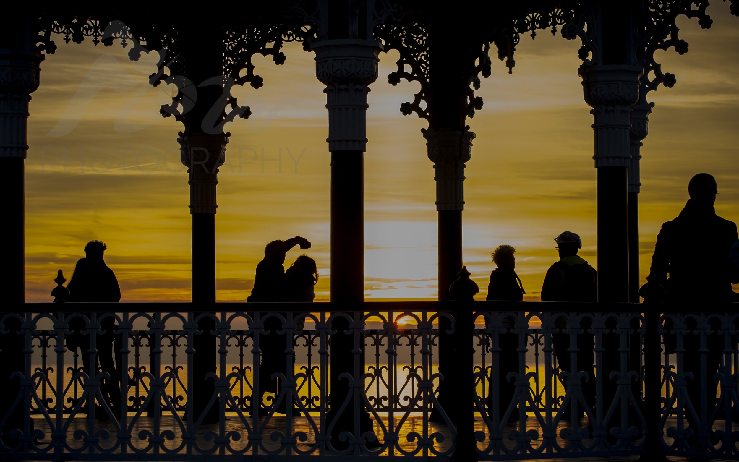 Sunset Selfies   The sun goes down on Brighton's Bandstand
