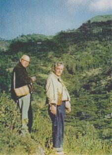 WITH professor Heim, Wasson ( right ) searches a mountainside near the village for specimens of the sacred mushrooms. They found two species here.
