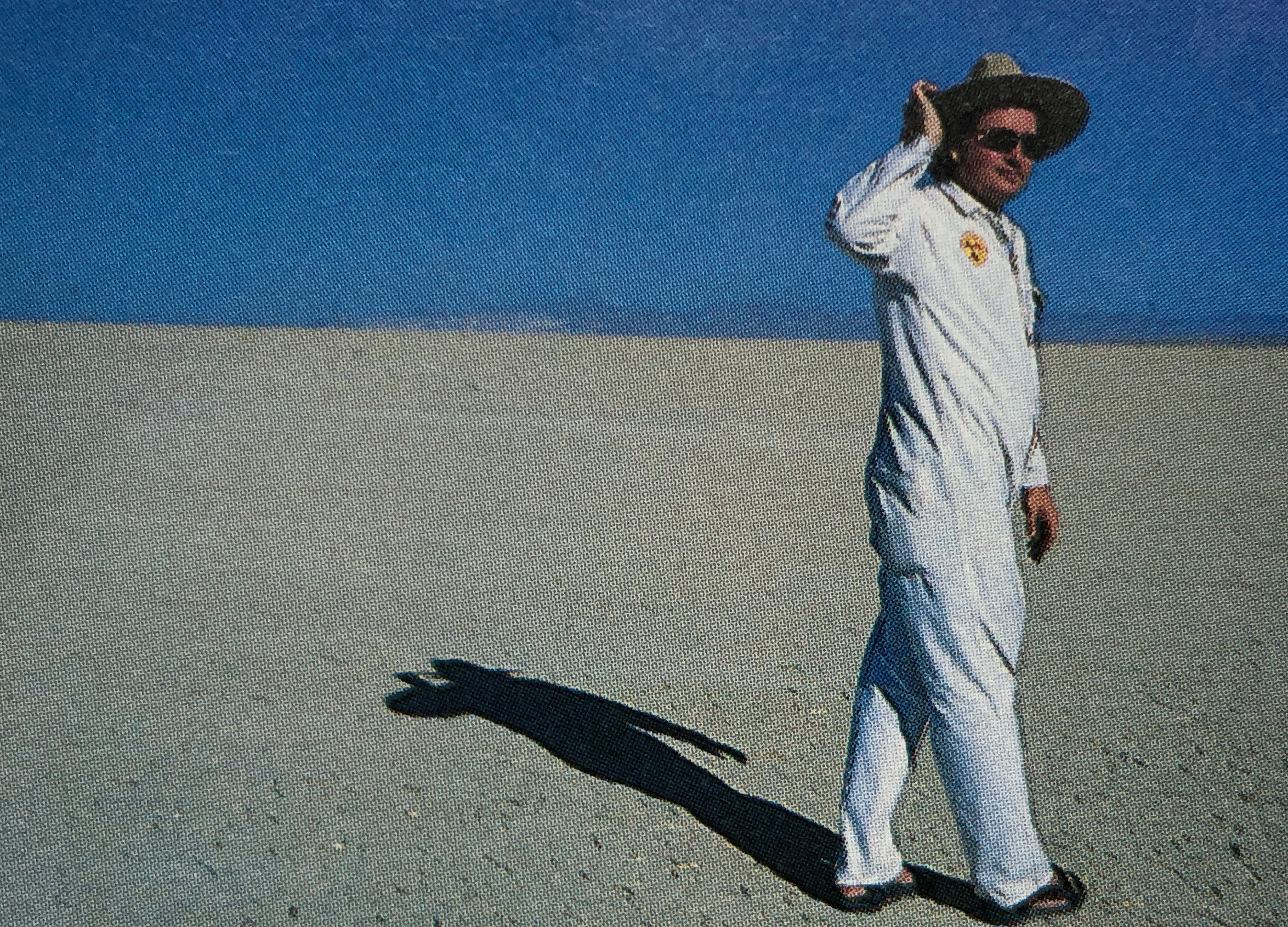 man in white suit.jpg