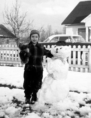 Larry in front yard, SE Holman St, winter 1953