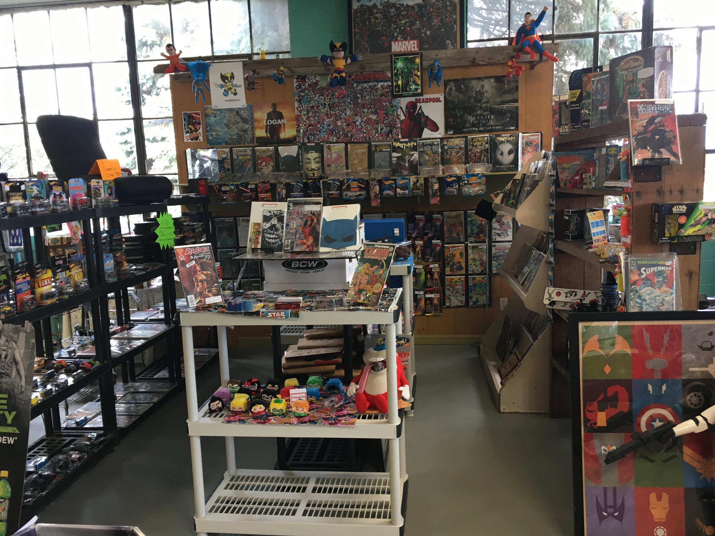 Wiz Collectibles - Comics, toys, hot wheels, hero figures, books, posters, sports cards, Pez dispensers, hero knives, cardboard stand ups, all from the 60's to current trends