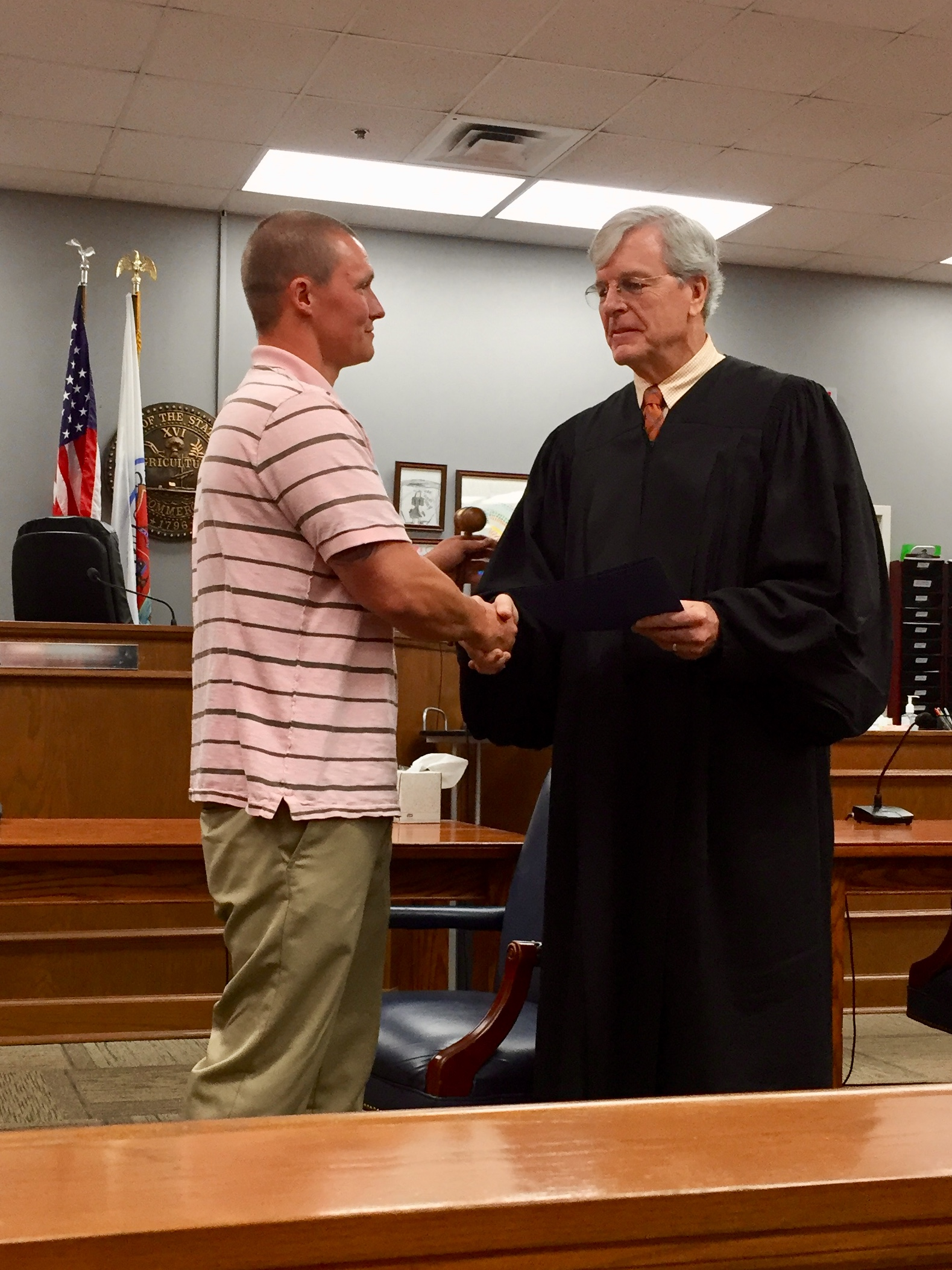 Graduate Brian being recognized by Judge James Martin